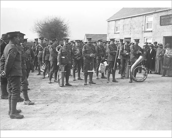 The Duke of Cornwall's Light Infantry band are about to start, or have just concluded, a march outside what is thought to be the Travellers Comfort Inn, possibly at Farms Common. This was probably part of a recruiting drive.