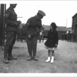 Porthleven, Cornwall. 14th June 1915. 3rd DCLI recruiting march. Lance Corporal Rendle VC being offered a sweet by schoolgirl Marjorie Shakerley. 1915. Photographer: Arthur William Jordan.