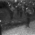 DCLI Recruiting march, St Kew, Cornwall, 13 August 1915. The Duke of Cornwall's Light Infantry band are playing as a young boy watches. Photographer: Arthur William Jordan.