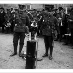 DCLI at unknown location. 1915The Duke of Cornwall's Light Infantry band are pictured with their dog mascot. Perhaps a 1915 recruiting march. Photographer: Arthur William Jordan.