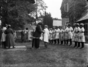 A group of the Women's Land Army at the presentation of their efficiency tests. Pictured at Tregavethan Farm. The awards were presented by Lady Ingeborg-St Aubyn. Photographer: A W Jordan. © From the collection of the RIC (TRURI-1972-2-340).