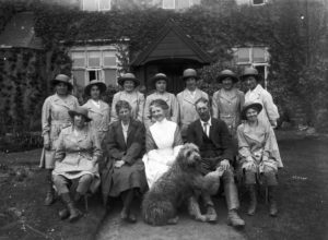 Nine members of the Women's Land Army pictured with the owners of Tregavethan Farm and their dog. Back row, left to right, is: Ms Brown, Mrs Ford, Ms Trejeweth, Ms Nora Lock, possibly Ms Vera Dunfrane, Ms I Crowther, and Ms Northey. Front row, left to right, is: unknown, Mrs A Martin (farm owner), Mrs Young (possibly Matron), Mr Alfred Martin (farm owner), and Ms Dorothy Phyllis Martin. Photographer: A W Jordan. © From the collection of the RIC (TRURI-1972-2-54).