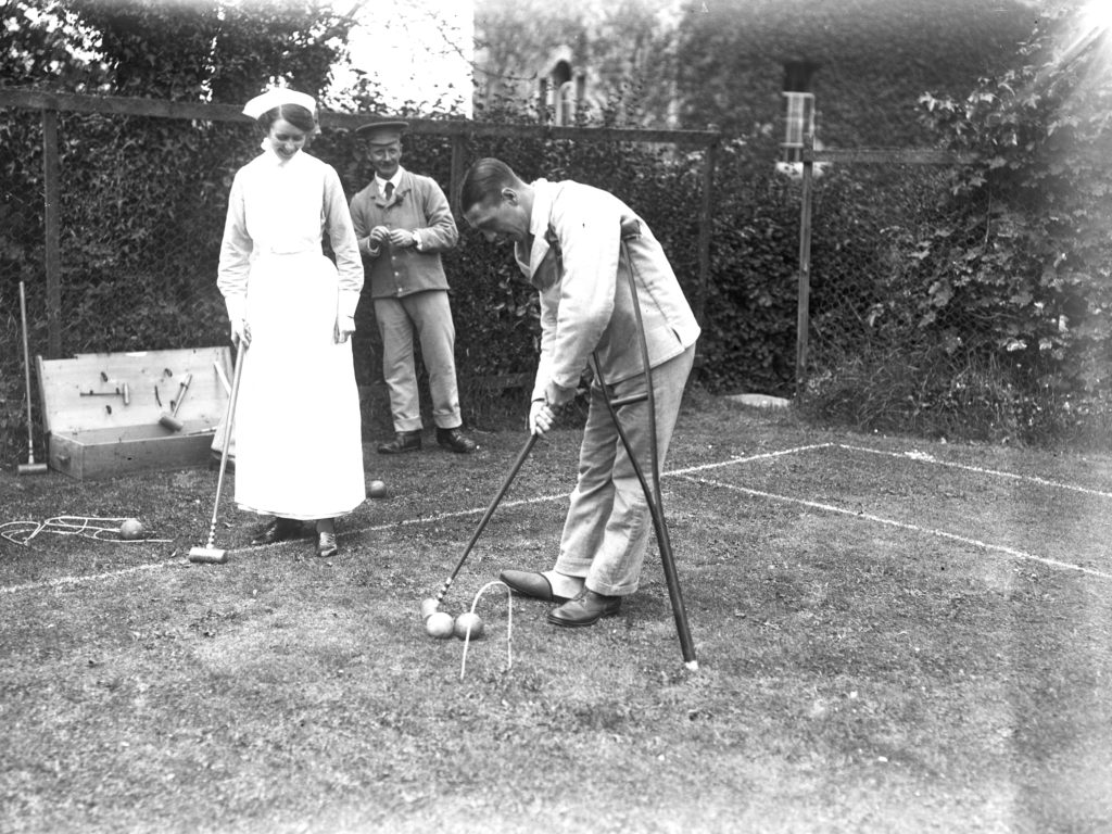 A patient, leaning on a crutch, and a nurse, playing croquet in the garden of the Royal Cornwall Infirmary - probably on 21st July 1916. Photographer A W Jordan. © From the collection of the RIC.
