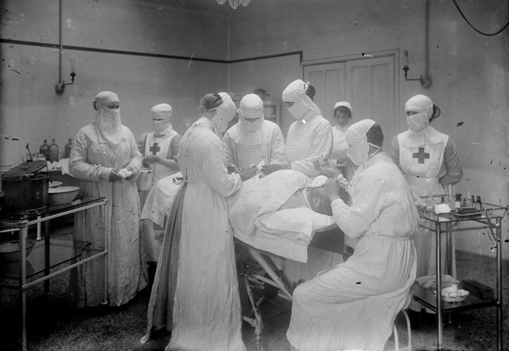 Operation in progress at the Royal Cornwall Infirmary in 1915, with Red Cross nurses. Photographer: A W Jordan. © From the collection of the RIC.