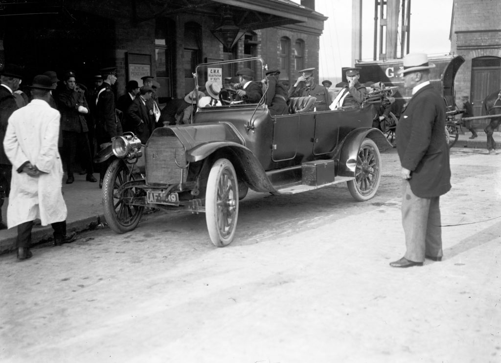 Wounded soldiers in an open car outside Truro Railway Station on 16th June 1915, en route to the Royal Cornwall Infirmary as the first batch of patients. Photographer: A W Jordan. © From the collection of the RIC.