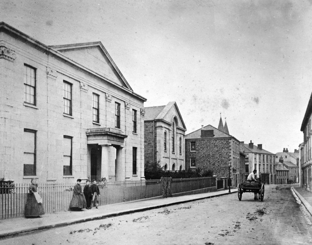 A view of River Street, looking east, showing the Truro Savings Bank and Baptist Chapel in the late 1800s, before conversion into the Royal Cornwall Museum.