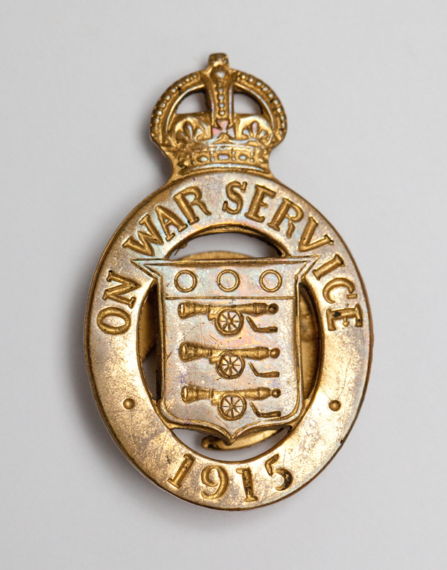 Image of an On War Service Badge circa. 1915. Badges like the one above, were awarded to acknowledge the effort being made by those on the Homefront and arguably defended civilian men in reserved occupations against accusations that they were 'shirking their responsibilities'.